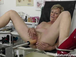 Czech mature was wearing red shoes with high heels while spreading up in the gynecologists office big tits blonde czech video